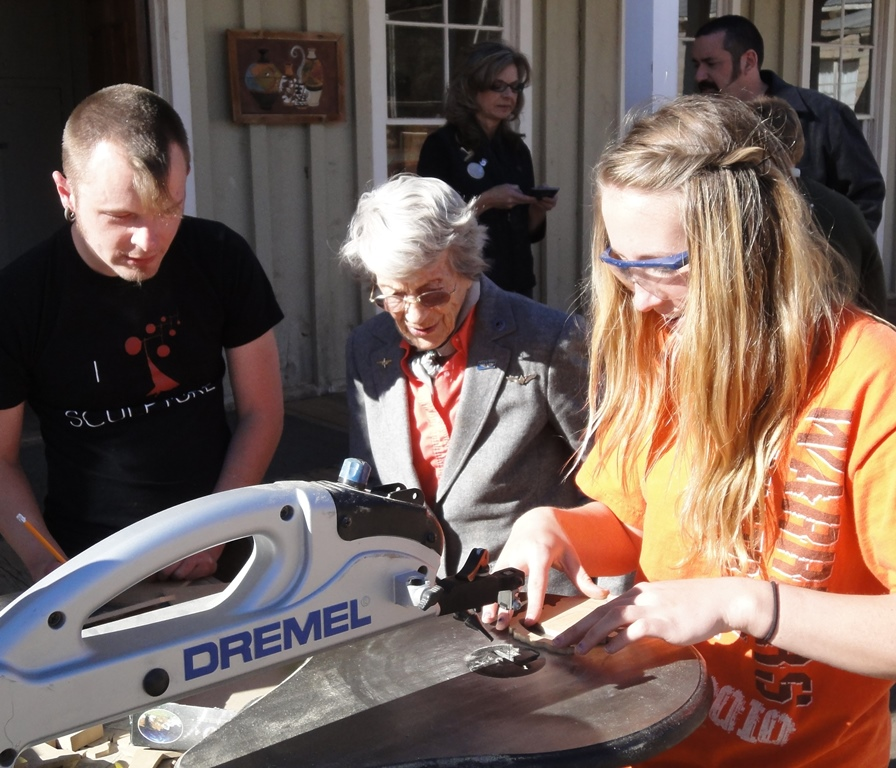 Mr. Chris Yates & Dot observes a student Dremel her way to Glory! - Click here for Chris's Website